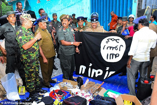 12783082-6966087-army_officers_pose_with_an_islamist_flag_after_their_ferocious_r-a-22_1556381130738