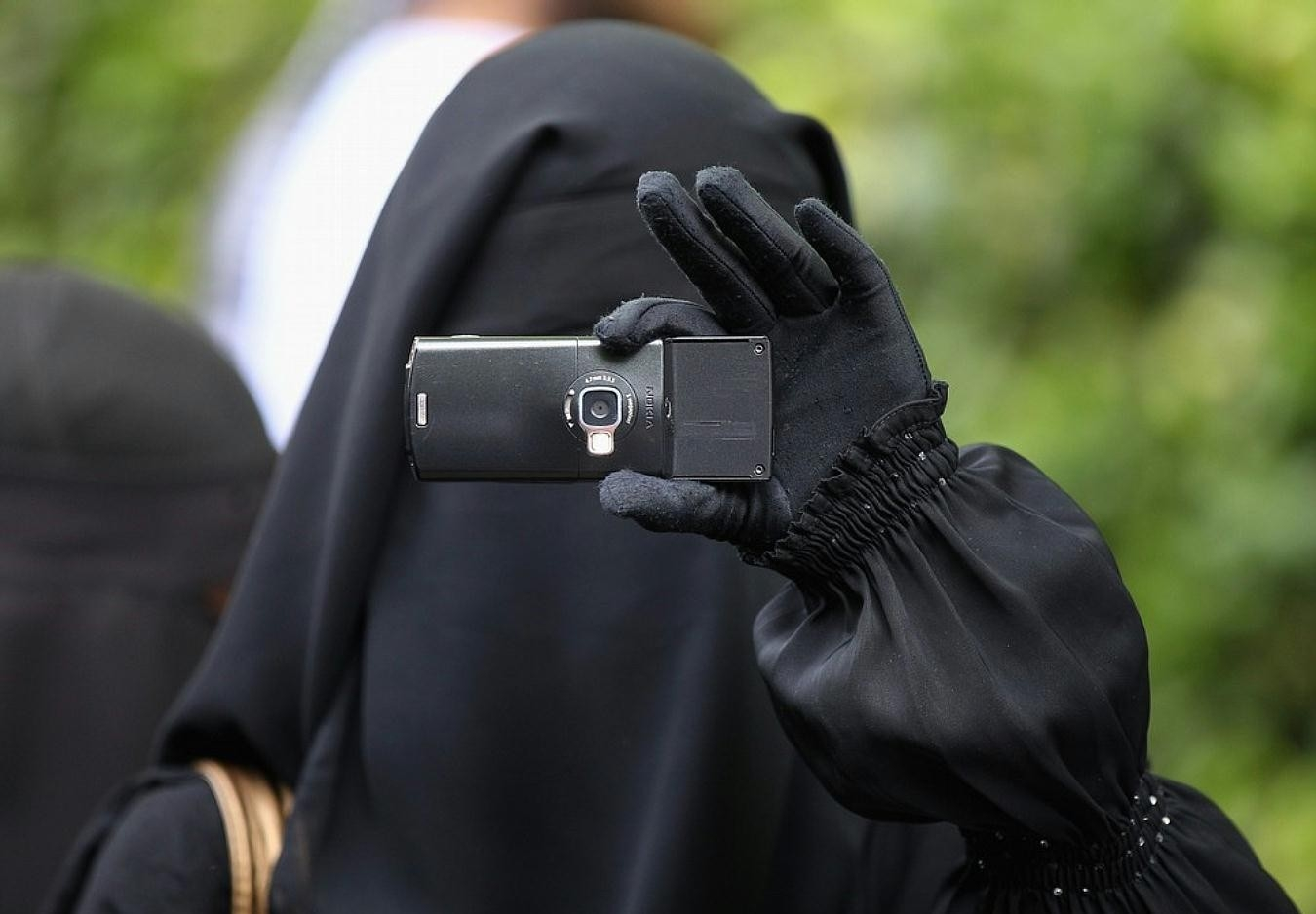 Lawyer protests wearing of veil, Pakistan blocks SIM of unvaccinated